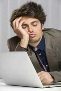 Sleeping overworked businessman at work